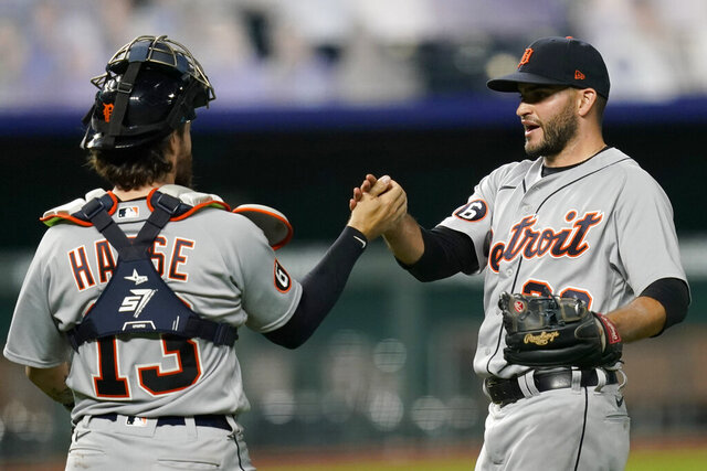 Detroit Tigers catcher Eric Haase (13) and relief pitcher Bryan Garcia, right, celebrate following a baseball game against the Kansas City Royals at Kauffman Stadium in Kansas City, Mo., Saturday, Sept. 26, 2020. The Tigers defeated the Royals 4-3. (AP Photo/Orlin Wagner)