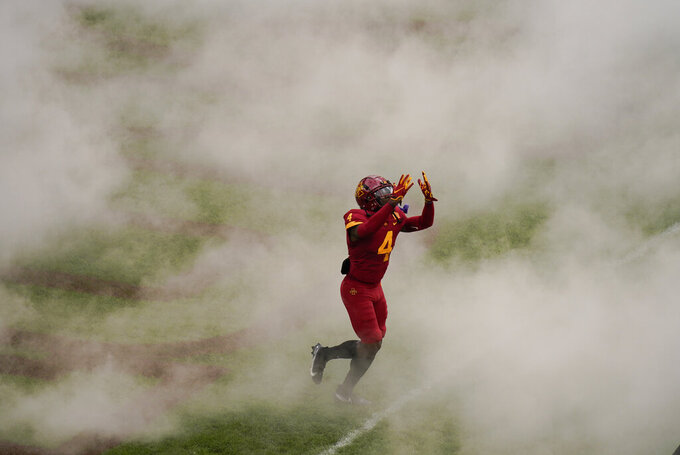 CORRECTS TO IOWA STATE DEFENSIVE BACK ARNOLD AZUNNA NOT RUNNING BACK JOHNNIE LANG JR.   Iowa State defensive back Arnold Azunna runs onto the field before an NCAA college football game against Louisiana-Lafayette, Saturday, Sept. 12, 2020, in Ames, Iowa. (AP Photo/Charlie Neibergall)