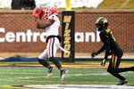 Georgia wide receiver George Pickens, left, catches a pass before running it in for a touchdown as Missouri safety Joshuah Bledsoe defends during the second half of an NCAA college football game Saturday, Dec. 12, 2020, in Columbia, Mo. (AP Photo/L.G. Patterson)