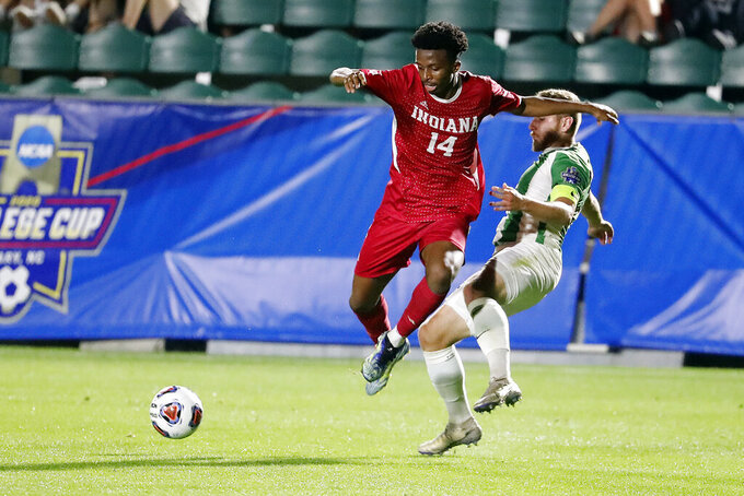 Indiana's Maouloune Goumballe (14) collides with Marshall's Jan-Erik Leinhos (30) during the first half of the NCAA College Cup championship soccer match in Cary, N.C., Monday, May 17, 2021. (AP Photo/Karl B DeBlaker)