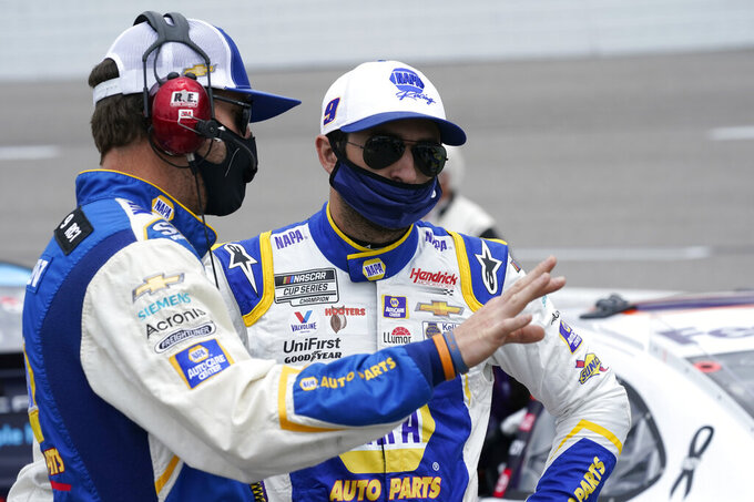 Chase Elliott, right, talks to his crew chief, Alan Gustafson, left, prior to the start of the NASCAR Cup Series auto race at Richmond International Raceway in Richmond, Va., Sunday, April 18, 2021. (AP Photo/Steve Helber)