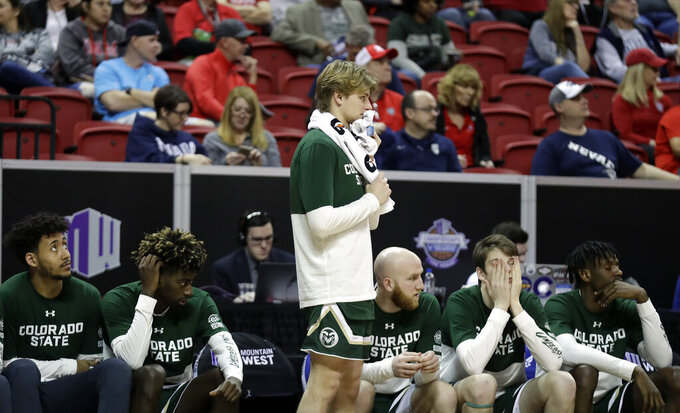 The Colorado State bench watches during the final minutes of the second half of an NCAA college basketball game in the Mountain West Conference tournament against Boise State Wednesday, March 13, 2019, in Las Vegas. (AP Photo/Isaac Brekken)
