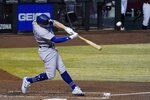 Los Angeles Dodgers' Enrique Hernandez connects for a home run against the Arizona Diamondbacks during the second inning of a baseball game Wednesday, Sept. 9, 2020, in Phoenix. (AP Photo/Ross D. Franklin)