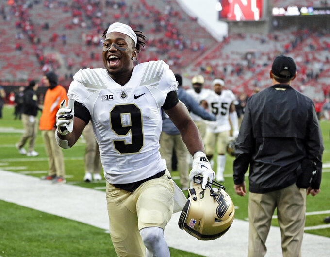 FILE - In this Sept. 29, 2018, file photo, Purdue wide receiver Terry Wright (9) celebrates as he leaves the field following an NCAA college football game against Nebraska in Lincoln, Neb. Purdue won 42-28. The Purdue Boilermakers finally look like the team Jeff Brohm envisioned. They're improving on defense, making big plays on offense and are chalking up wins.(AP Photo/Nati Harnik, File)