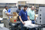Employees at the Broward County Supervisor of Elections office sort ballots before being counted, Monday, Nov. 12, 2018, in Lauderhill, Fla. (AP Photo/Wilfredo Lee)