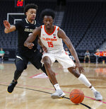 Clemson's John Newman III (15) drives around Colorado's Daylen Kountz (2) during the first half on an NCAA college basketball game, Tuesday, Nov. 26, 2019, in Las Vegas. (AP Photo/John Locher)