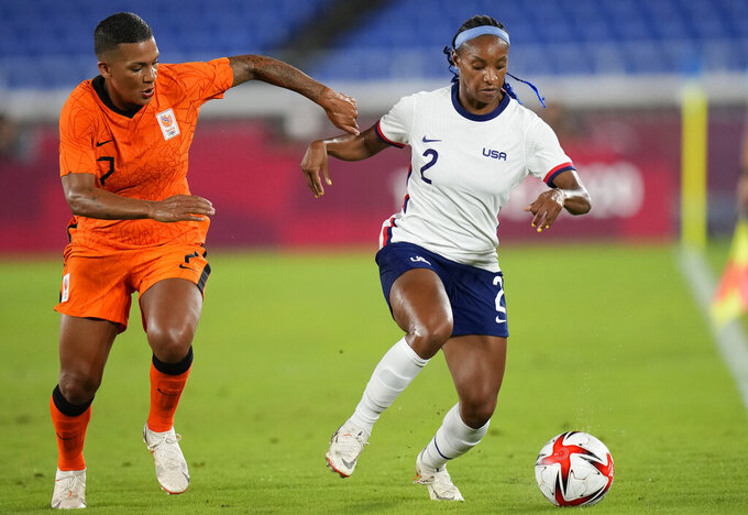 United States' Crystal Dunn, right, and Netherlands' Shanice van de Sanden battle for the ball during a women's quarterfinal soccer match at the 2020 Summer Olympics, Friday, July 30, 2021, in Yokohama, Japan. (AP Photo/Silvia Izquierdo)