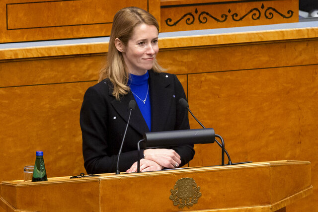 Newly appointed Estonian Prime Minister Kaja Kallas speaks at the Estonian Parliament, in Tallinn, Estonia, Tuesday, Jan. 26, 2021. Estonia's new two-party coalition government has been sworn in with the first female prime minister since the Baltic country regained independence in 1991. The 15-member Cabinet of Prime Minister Kaja Kallas — a 43-year-old lawyer and a former European Parliament lawmaker — was approved Tuesday in the 101-seat Riigikogu legislature. (AP Photo/Raul Mee)