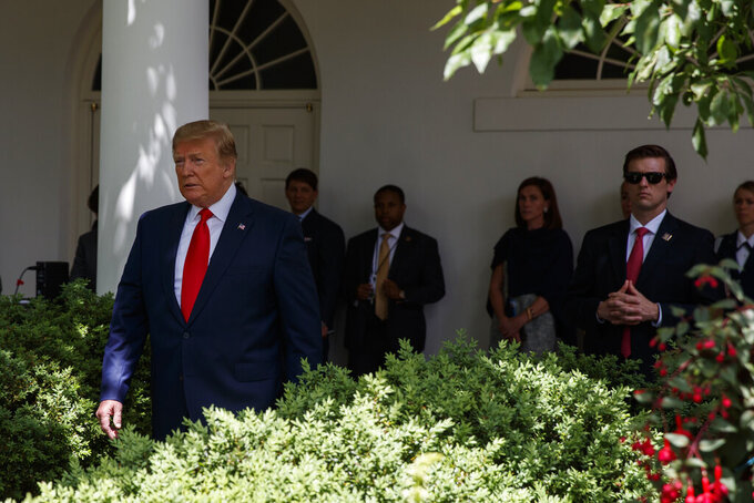 President Donald Trump arrives to speak during the presentation of the Commander-in-Chief's Trophy to the U.S. Military Academy at West Point football team, in the Rose Garden of the White House, Monday, May 6, 2019, in Washington. (AP Photo/Evan Vucci)