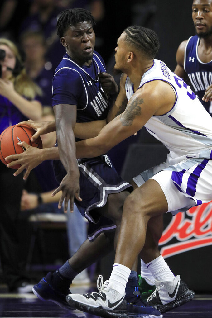 Kansas State forward Levi Stockard III, right, passes the ball past around Monmouth guard Ray Salnave during the first half of an NCAA college basketball game in Manhattan, Kan., Wednesday, Nov. 13, 2019. (AP Photo/Orlin Wagner)