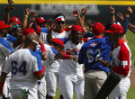 Dominican Republic players celebrate their 8-5 victory against Venezuela at the end of a final Olympic baseball qualifier game, in Puebla, Mexico, Saturday, June 26, 2021. (AP Photo/Fernando Llano)