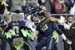 Seattle Seahawks tight end Jacob Hollister, center, celebrates with wide receiver David Moore, upper right, and the Seahawks mascot after Hollister scored a touchdown in overtime an NFL football game against the Tampa Bay Buccaneers, Sunday, Nov. 3, 2019, in Seattle. The Seahawks won 40-34. (AP Photo/John Froschauer)