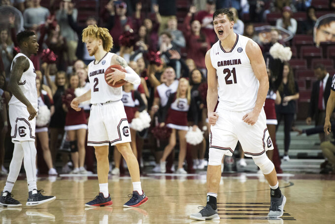 South Carolina forward Maik Kotsar (21) celebrates at the conclusion of the team's NCAA college basketball game against Mississippi State on Tuesday, Jan. 8, 2019, in Columbia, S.C. South Carolina defeated Mississippi State 87-82 in overtime. (AP Photo/Sean Rayford)