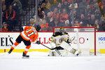 Philadelphia Flyers' Travis Konecny (11) scores a goal past Boston Bruins goaltender Jaroslav Halak in a shootout during an NHL hockey game, Monday, Jan. 13, 2020, in Philadelphia. The Flyers won 6-5. (AP Photo/Derik Hamilton)