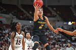Missouri guard Akira Levy (2) shoots in front of Mississippi State center Teaira McCowan (15) during the second half of an NCAA college basketball game Thursday, Feb. 14, 2019, in Starkville, Miss. Missouri won 75-67. (AP Photo/Rogelio V. Solis)