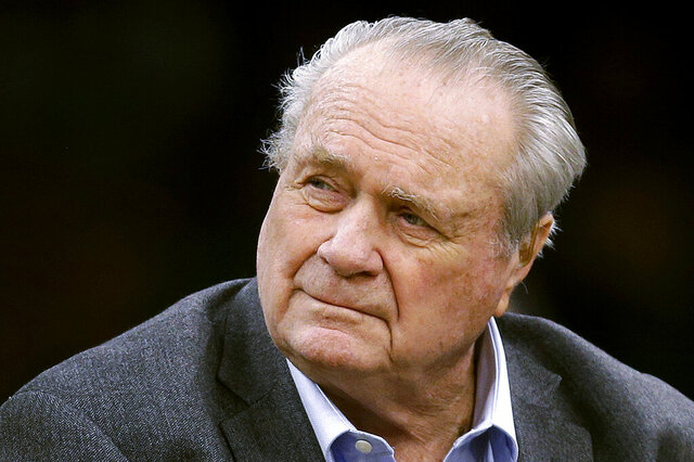 FILE - This Sept. 30, 2018, file photo shows former Boston Celtics great Tommy Heinsohn prior to a preseason basketball game in Boston. Tommy Heinsohn, who as a Boston Celtics player, coach and broadcaster was with the team for all 17 of its NBA championships, has died. He was 86. The team confirmed Heinsohn's death on Tuesday, Nov. 10, 2020. (AP Photo/Charles Krupa, File)