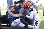 Cincinnati Bengals' Mackensie Alexander (21) talks with Tennessee Titans' Adam Humphries (10) after Humphries was injured on a play during the first half of an NFL football game, Sunday, Nov. 1, 2020, in Cincinnati. (AP Photo/Jay LaPrete)