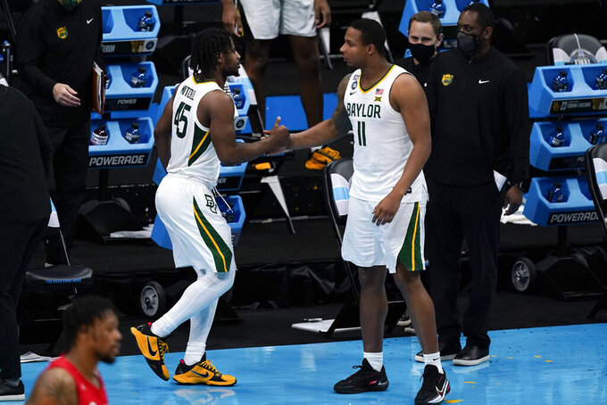 Baylor guard Davion Mitchell (45) celebrates with teammate guard Mark Vital (11) at the end of a men's Final Four NCAA college basketball tournament semifinal game against Houston, Saturday, April 3, 2021, at Lucas Oil Stadium in Indianapolis. (AP Photo/Michael Conroy)