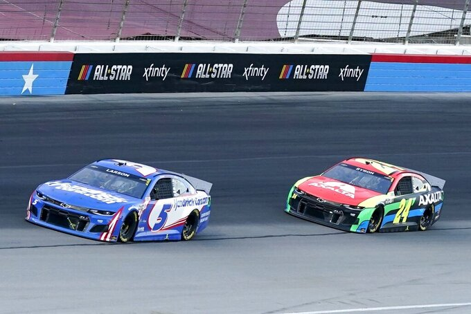 Kyle Larson (5) William Byron (24) head out of Turn 4 into the front stretch during the NASCAR Cup Series All-Star auto race at Texas Motor Speedway in Fort Worth, Texas, Sunday, June 13, 2021. (AP Photo/Tony Gutierrez)