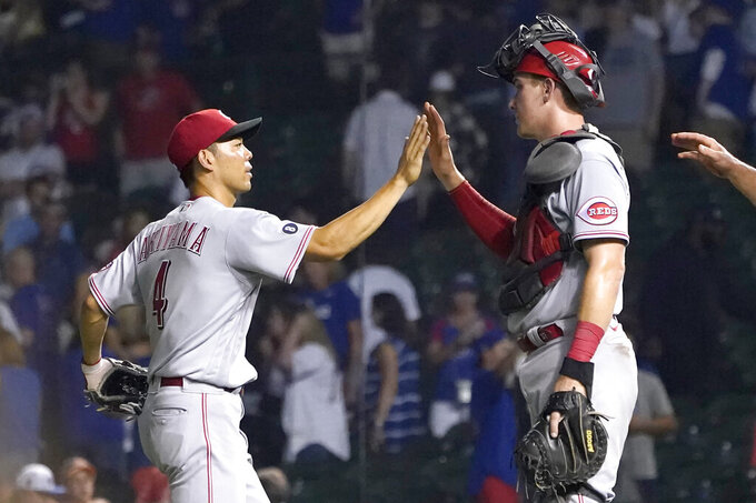 Cincinnati Reds' Shogo Akiyama, left, and catcher Tyler Stephenson celebrate the team's 8-2 win one the Chicago Cubs in a baseball game Wednesday, July 28, 2021, in Chicago. (AP Photo/Charles Rex Arbogast)