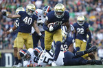 Notre Dame defensive lineman Adetokunbo Ogundeji (91) runs a fumble he recovered in for a touch down while playing Virginia in the second half of an NCAA college football game in South Bend, Ind., Saturday, Sept. 28, 2019. Notre Dame won 35-20. (AP Photo/AJ Mast)
