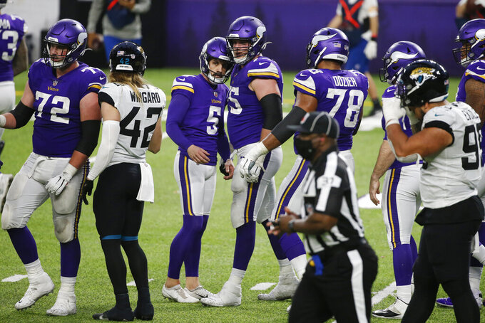 Minnesota Vikings place kicker Dan Bailey (5) celebrates with teammates after kicking a 23-yard field goal during overtime in an NFL football game against the Jacksonville Jaguars, Sunday, Dec. 6, 2020, in Minneapolis. The Vikings won 27-24. (AP Photo/Bruce Kluckhohn)