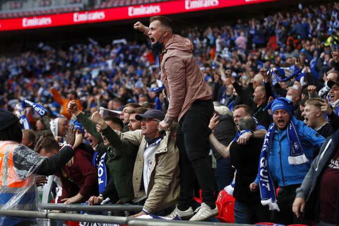 Leicester City fans celebrate during the FA Cup final soccer match between Chelsea and Leicester City at Wembley Stadium in London, England, Saturday, May 15, 2021. (Matt Childs/Pool via AP)