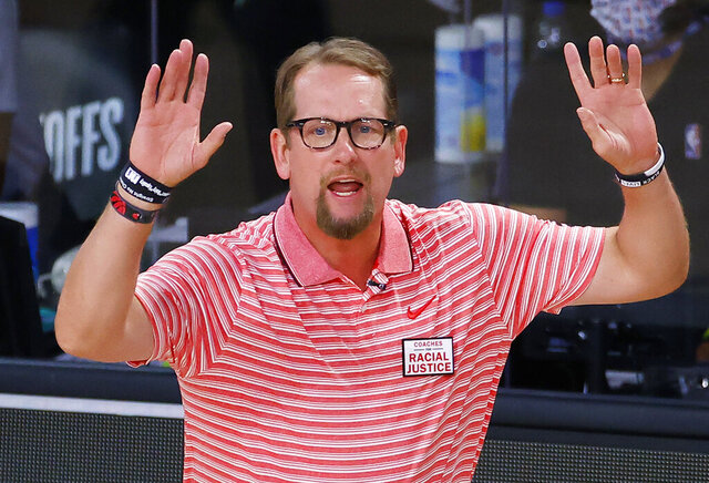 Toronto Raptors coach Nick Nurse gestures during Game 1 of the team's NBA basketball first-round playoff series against the Brooklyn Nets, Monday, Aug. 17, 2020, in Lake Buena Vista, Fla. (Kevin C. Cox/Pool Photo via AP)