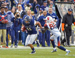 Notre Dame safety Alohi Gilman (11) returns interception during an NCAA college football game against Syracuse, Saturday, Nov. 17, 2018, at Yankee Stadium in New York. (AP Photo/Howard Simmons)