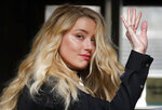 FILE - In this file photo dated Tuesday, July 28, 2020, US Actress Amber Heard, former wife of actor Johnny Depp, arrives at the High Court in London.  Britain's judicial office said Tuesday Oct. 27, 2020, that judge Andrew Nicol will deliver his verdict in writing on Nov. 2, ruling on whether Johnny Depp was libelled by a tabloid newspaper that accused him of assaulting his then wife Amber Heard. (AP Photo/Frank Augstein, FILE)