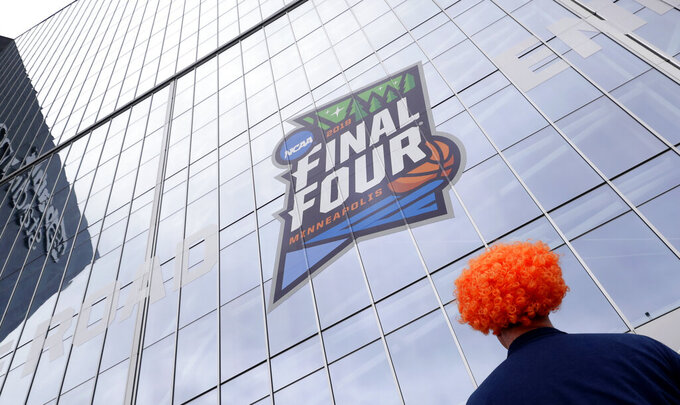 A fan waits outside U.S. Bank Stadium before a semifinal round game between Auburn and Virginia at the Final Four NCAA college basketball tournament, Saturday, April 6, 2019, in Minneapolis. (AP Photo/Matt York)