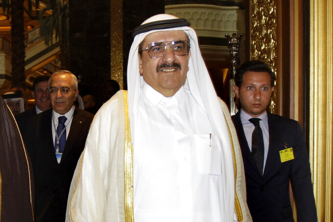FILE - In this Sept. 7, 2011, file photo, Sheikh Hamdan bin Rashid Al Maktoum, deputy ruler of Dubai and United Arab Emirates minister of finance attends the opening of Arab Finance Ministers Exceptional meeting in Abu Dhabi, United Arab Emirates. He has died, his brother said on Wednesday, March 24, 2021. He was 75. (AP Photo/Kamran Jebreili, File)
