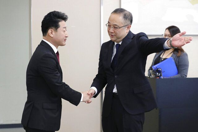 FILE - In this Dec. 16, 2019, photo, Lee Ho-hyeon, left, director-general for International Trade Policy at South Korea's Trade, Industry and Energy Ministry, is shown the way by Yoichi Iida, director-general of Japan's Trade Control Department before a director-general level meeting at the trade ministry in Tokyo. Japan's trade ministry said Friday, Dec. 20, 2019, that it has eased controls on exports to South Korea of one of three chemicals used in semiconductors that it had restricted, a sign of a thaw between the two countries just days before their leaders meet in China. (Kyodo News via AP, File)
