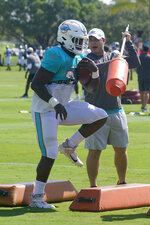 Miami Dolphins wide receiver William Fuller (3) does drills during a NFL football practice, Thursday, Aug. 19, 2021, in Miami Gardens, Fla. (AP Photo/Marta Lavandier)