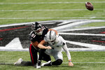 Atlanta Falcons defensive tackle Jacob Tuioti-Mariner (91) hits Las Vegas Raiders quarterback Derek Carr (4) for a fumble during the first half of an NFL football game, Sunday, Nov. 29, 2020, in Atlanta. The Atlanta Falcons recovered the ball. (AP Photo/John Bazemore)