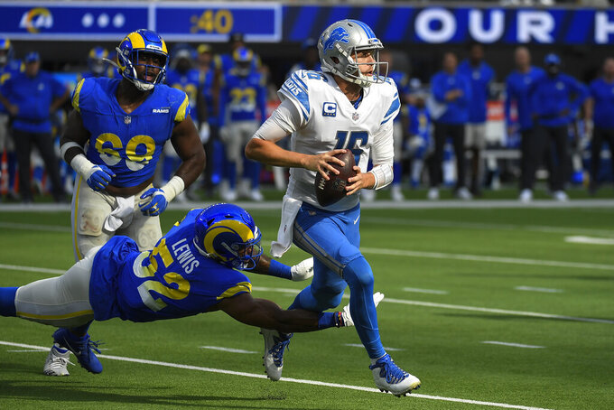 Detroit Lions quarterback Jared Goff gets away from Los Angeles Rams linebacker Terrell Lewis, below, during the second half of an NFL football game against the Los Angeles Rams Sunday, Oct. 24, 2021, in Inglewood, Calif. (AP Photo/Kevork Djansezian)