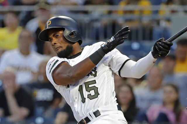 FILE - In this Sept. 5, 2019, file photo, Pittsburgh Pirates' Pablo Reyes drives in a run with a double off Miami Marlins starting pitcher Elieser Hernandez during the first inning of a baseball game in Pittsburgh. Reyes was suspended 80 games on Wednesday, Feb. 19, under the major league drug program following a positive test for the performance-enhancing drug Boldenone. He became the second player in three days suspended for Boldenone, which is sold under the brand name Equipose and is used commonly on horses. Houston pitcher Francis Martes was suspended for the 2020 season on Monday following a positive test for Boldenone, his second violation of the major league drug program. (AP Photo/Gene J. Puskar, File)
