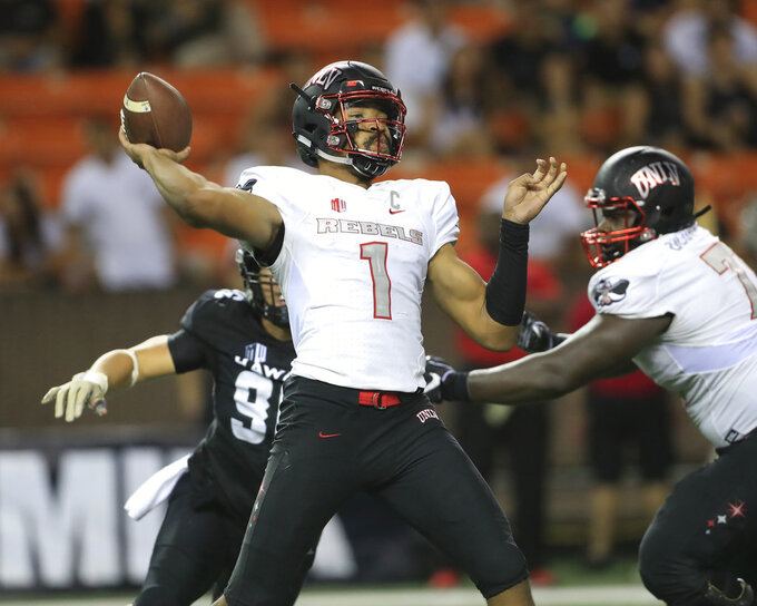 UNLV quarterback Armani Rogers (1) makes a pass against Hawaii during the fourth quarter of an NCAA college football game, Saturday, Nov. 17, 2018, in Honolulu. Hawaii defeated UNLV 35-28. (AP Photo/Marco Garcia)