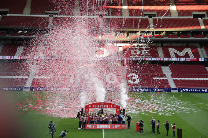 Atletico Madrid players celebrate at the Wanda Metropolitano stadium in Madrid, Spain, Sunday, May 23, 2021. Atletico Madrid survived a dramatic final round to clinch its first Spanish league title since 2014 with a 2-1 come-from-behind win at Valladolid on Saturday. (AP Photo/Manu Fernandez)