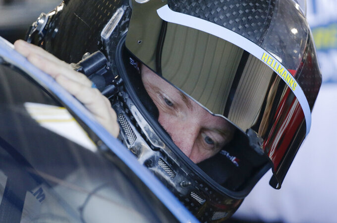 Dale Earnhardt Jr. gets in his car before practice for a NASCAR Xfinity Series auto race at Darlington Raceway on Saturday, Aug. 30, 2019, in Darlington, S.C.. (AP Photo/Terry Renna)