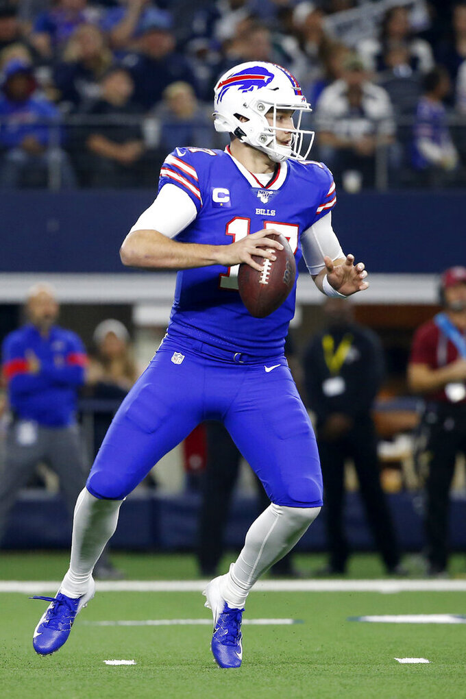 Buffalo Bills quarterback Josh Allen (17) drops back to pass in the first half of an NFL football game against the Dallas Cowboys in Arlington, Texas, Thursday, Nov. 28, 2019. (AP Photo/Ron Jenkins)
