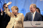 Armin Laschet, chairman of the German Christian Democratic Union (CDU) and the party's top candidate for the federal election, right, and German chancellor Angela Merkel attend a joint campaign appearance in Stralsund, Germany, Tuesday Sept, 21, 2021. (Bernd Wustneck/dpa via AP)