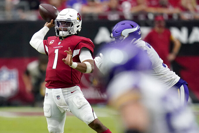 Arizona Cardinals quarterback Kyler Murray (1) throws against the Minnesota Vikings during the second half of an NFL football game, Sunday, Sept. 19, 2021, in Glendale, Ariz. (AP Photo/Ross D. Franklin)