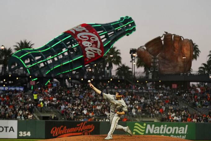 Milwaukee Brewers' Corbin Burnes pitches against the San Francisco Giants during the third inning of a baseball game in San Francisco, Monday, Aug. 30, 2021. (AP Photo/Jeff Chiu)
