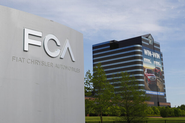 FILE - This May 27, 2019, file photo shows the Fiat Chrysler Automobiles world headquarters in Auburn Hills, Mich. A federal judge in Detroit dismissed General Motors' lawsuit Wednesday, July 8, 2020, alleging that rival Fiat Chrysler paid off union leaders to get better contract terms than GM. (AP Photo/Paul Sancya, File)