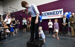Democratic U.S. Rep. Joseph Kennedy III, D-Mass., reacts as his son James Kennedy, 1, attempts to climb onto the podium as he announces his candidacy for the Senate on Saturday, Sept. 21, 2019, in Boston. Kennedy will challenge incumbent Sen. Ed Markey in the Democratic primary. (AP Photo/Josh Reynolds)
