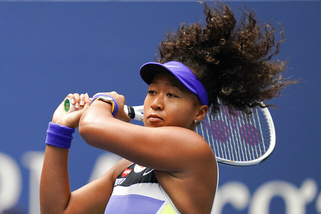 FILE - In this Sept. 12, 2020, file photo, Naomi Osaka, of Japan, returns a shot to Victoria Azarenka, of Belarus, during the women's singles final of the US Open tennis championships, in New York. U.S. Open champion Osaka has pulled out of the French Open because of an injured hamstring.  Osaka joins No. 1-ranked Ash Barty in skipping the French Open, which opens on Monday, Sept. 21. (AP Photo/Seth Wenig, File)
