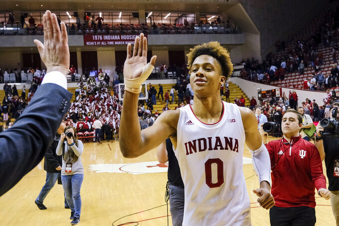 Indiana guard Romeo Langford gets a high-five from a member of the basketball staff after the team's NCAA college basketball game against Wisconsin in Bloomington, Ind., Tuesday, Feb. 26, 2019. Indiana won 75-73 in double overtime. (AP Photo/AJ Mast)