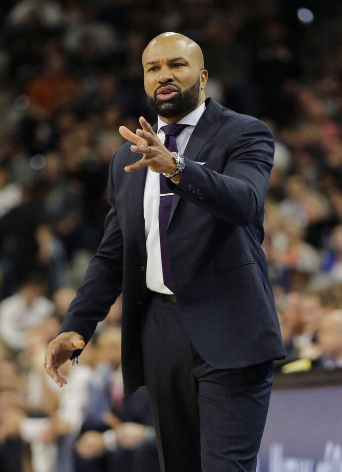 FILE - In this Jan. 8, 2016, file photo, New York Knicks head coach Derek Fisher talks to his players during the first half of an NBA basketball game against the San Antonio Spurs,  in San Antonio. Former NBA player and coach Derek Fisher has been hired to coach the WNBA's Los Angeles Sparks. The Sparks announced the move Wednesday, Dec. 5, 2018 .(AP Photo/Eric Gay, File)