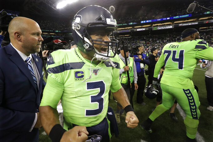 Seattle Seahawks quarterback Russell Wilson reacts after the Seahawks defeated the Los Angeles Rams 30-29 in an NFL football game Thursday, Oct. 3, 2019, in Seattle. (AP Photo/Elaine Thompson)